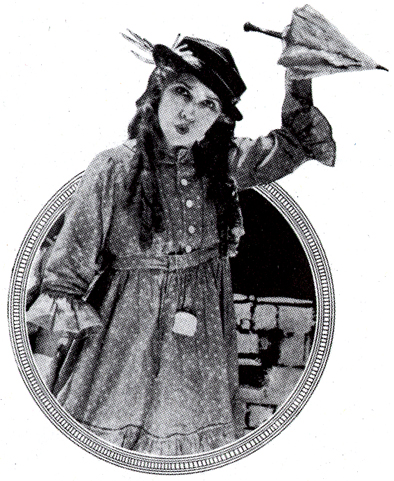 Mary Pickford i klänning och med paraply i högsta hugg